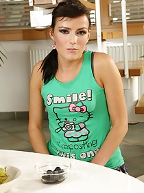 Raven-haired beauty with tiny tits showing her cute pussy next to the table