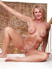 Black lingerie short-haired blonde MILF shows her juicy pussy