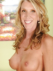 Blond-haired MILF with an interesting face shows her perfect labia