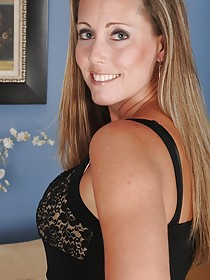 Blond MILF dressed in black shows that massive mature ass from behind