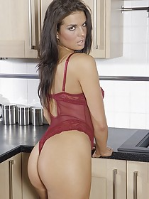 Tanned and leggy brunette in stockings showing off her juicy pussy