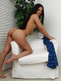 Striped top Latina takes off her seductive get-up and masturbates