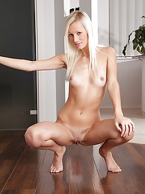 Flat-chested blonde takes off her tight black pants for the viewer